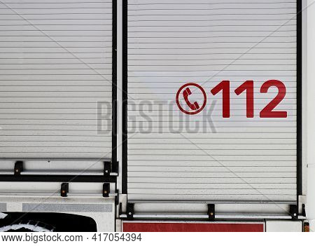 Number 112 On The Firetruck. Common European And Worldwide Emergency Number On The Vehicle Of The Em