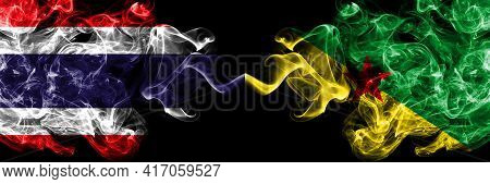 Thailand, Thai Vs France, French Guiana Smoky Mystic Flags Placed Side By Side. Thick Colored Silky