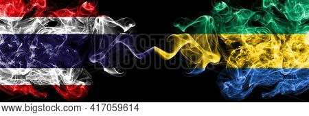 Thailand, Thai Vs Gabon, Gabonese, Gabonian Smoky Mystic Flags Placed Side By Side. Thick Colored Si