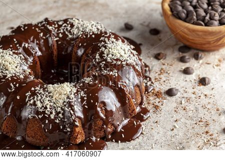 Chocolate Cake With Melted  Pudding Icing And Chocolate Chips In A Bowl In The Background. The Decor