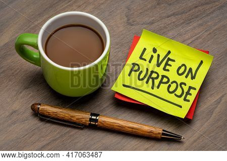 Live on purpose inspirational note - handwriting on a sticky note with a cup of coffee, personal development, goals and lifestyle concept
