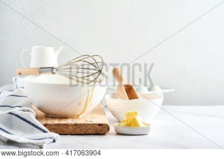 Preparation Of Dough For Home Pancakes For Breakfast Or For Maslenitsa. Ingredients On The Table - W
