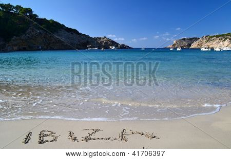 The word Ibiza written in the sand