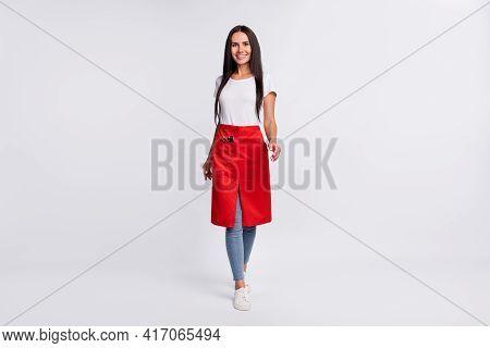 Full Size Photo Of Optimistic Brunette Long Hairdo Lady Go Wear T-shirt Jeans Isolated On Grey Backg