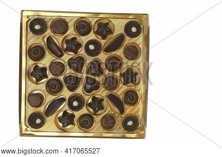 Chocolate Truffles Assortment. Sweets And Chocolate. Chocolate Candy Box On Brown Background.assortm