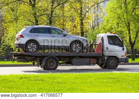 Hatchback Car Loaded Onto A Tow Truck Ready For Transport