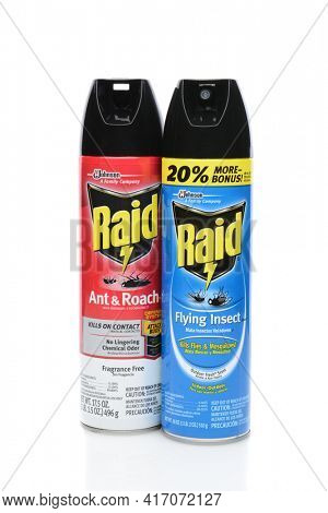 IRVINE, CA - SEPTEMBER 08, 2014: Two cans of Raid Insecticide. Raid is the brand name of a line of insecticide products produced by S. C. Johnson and  Son, first launched in 1956.
