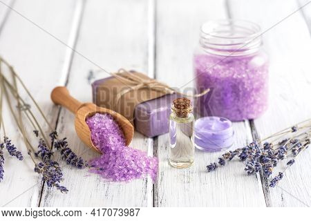 Lavender Spa Products On An Old White Wooden Table. Body Care Products With Lavender-oil, Salt, Crea