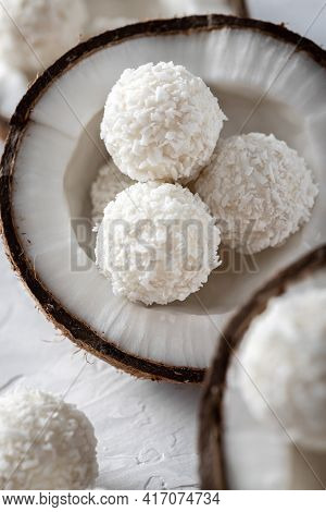 Portions Of White Chocolate Coconut Candy Balls In Raw Cracked Coconut Closeup