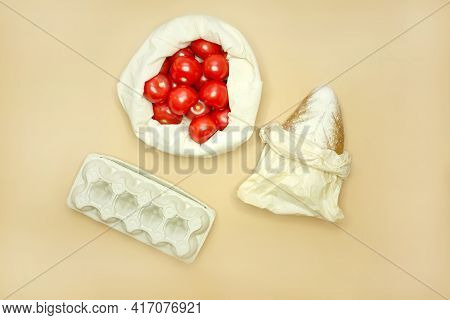 The Concept Of Shopping Without Waste - Bread In Paper Packaging And Eggs In Carton Packages, Tomato