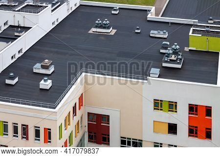 Top View Dark Flat Roof With Air Conditioners And Hydro Insulation Membranes Modern Apartment Buildi