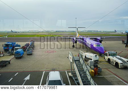 Copenhagen, Denmark - 24.10.2019: Airport View With Airplanes And Service Vehicles. Preparation Of A