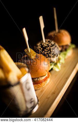 Three Mini Burgers And Fries