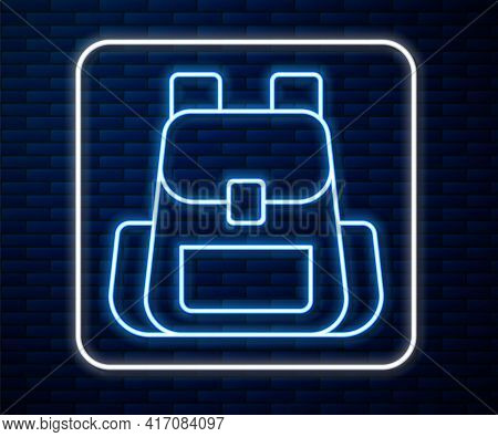 Glowing Neon Line Hiking Backpack Icon Isolated On Brick Wall Background. Camping And Mountain Explo