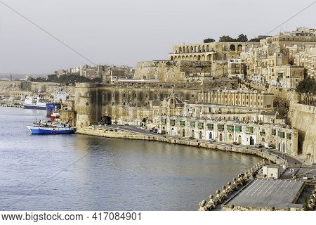 Panorama Of Valletta, St.barbara Bastion And Fort Laskaris At Early Foggy Morning. Architectural Mon