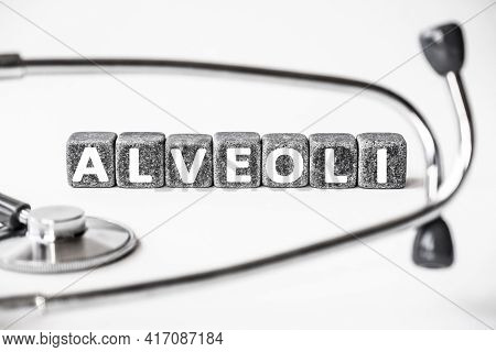 Stone Block Form Word Alveoli With Stethoscope. White Background. Medical Concept. Tiny Air Sacs In