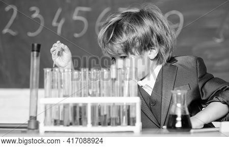 Science Experiments In Lab. Little Boy Is Making Science Experiments. Biology Science. Little Boy At
