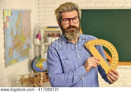 Confident Teacher. Math Teacher At Blackboard. Education. Exact Sciences. Bearded Teacher In Glasses