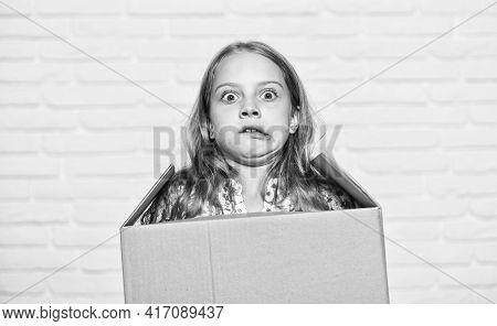Make Moving Easier. Girl Small Child Carry Cardboard Box. Move Out Concept. Prepare For Moving. Rent
