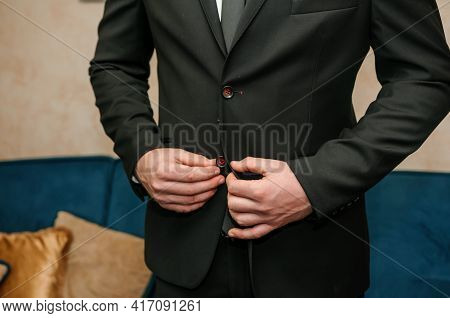 The Man Fasten A Button On His Jacket. The Groom Fasten A Button On His Jacket