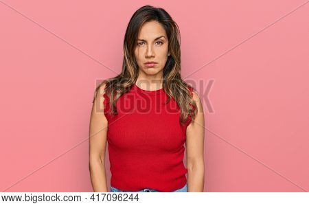 Young hispanic woman wearing casual clothes skeptic and nervous, frowning upset because of problem. negative person.