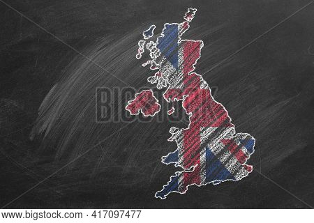 Country Map And Flag Of United Kingdom Drawing With Chalk On A Blackboard. Hand Drawn Animation. One