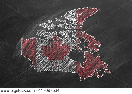 Country Map And Flag Of Canada Drawing With Chalk On A Blackboard. One Of A Large Series Of Maps And