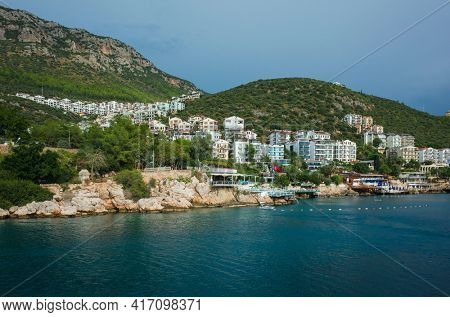 Kas, Turkey - 16 October, 2019: Picturesque coastal town on hills, Popular tourist destination on Turkish Mediterranean coast