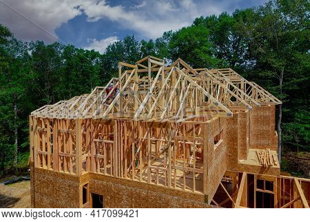 Wood Building Frame Beam Roofing Structure On A New Development Framing Of New House Under Construct