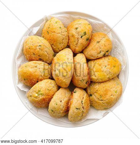 Steam buns with leeks and garlic, homemade pastries, freshly baked buns on a plate, isolated on a white background