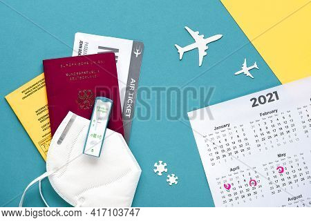 New Normal Travel During Covid-19 Restrictions. Pack Of Documents - Vaccination Certificate, German