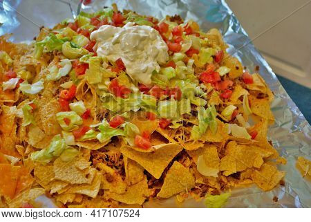 Nacho Table Kitchen Table Wrapped In Aluminum Foil And Covered With Nachos
