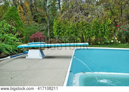 Backyard Swimming Pool With Diving Board Emptied Out Shutting Down For Winter