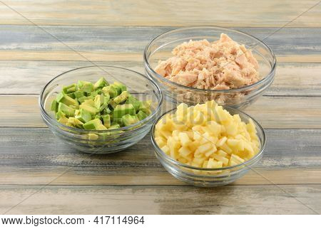 Chopped Avocado, Apple And Albacore Tuna Soaked In Glass Ingredient Bowls For Preparing Tuna Salad