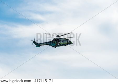 Sheriff Helicopter Hovering On A Beautiful Sky Background. Sheriff Department Helicopter On A Routin