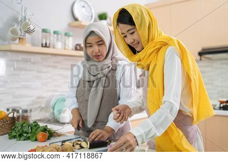 Muslim Woman Enjoy Cooking Dinner Together For Iftar Breaking The Fast On Ramadan