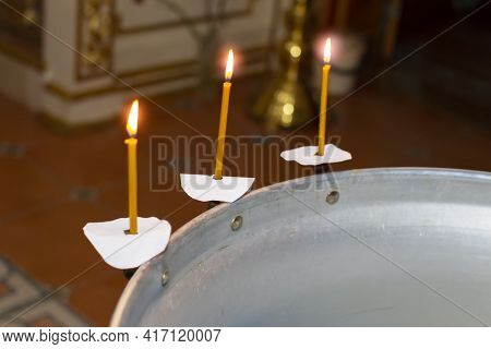 Part Of The Baptismal Font For A Child With Lit Candles. Church Background For Orthodox Baptism.