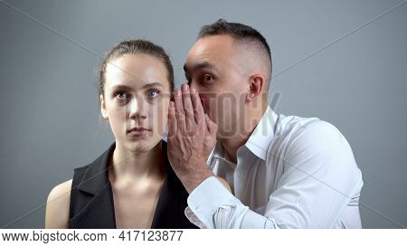 Photo Of Two Gossipers On Grey Background