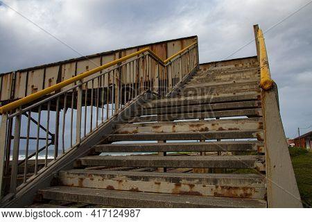 Rusty Steel Pedestrian Bridg Over Railway Line