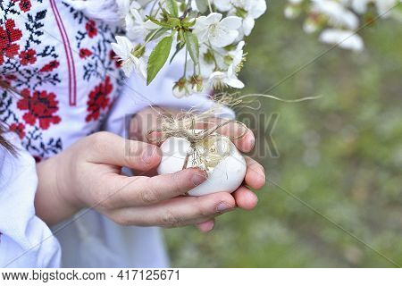 Happy Easter Day.caucasian Girl Holding Colored Eggs .girl In A Traditional Embroidered Shirt In A B