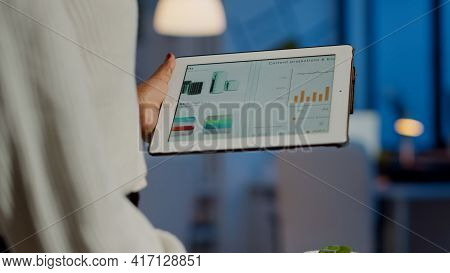 Close Up Of Black Entrepreneur Analysing Financial Reports Zoom In