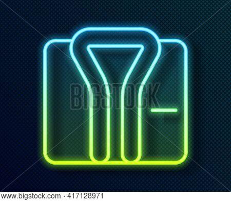 Glowing Neon Line Bathrobe Icon Isolated On Black Background. Vector