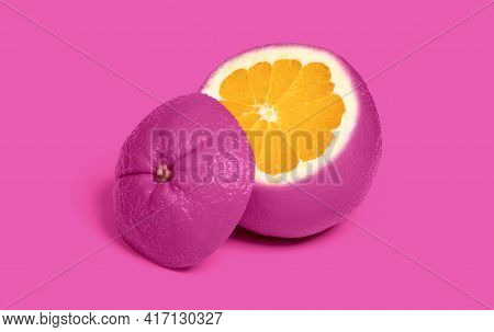 Weird Pink Sliced Orange Isolated On A Pink Background