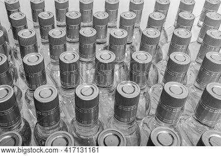 Bottles Of Pure Alcohol Not Labeled. Multitude Bottles Of Home Alcoholic Beverages Isolated On White