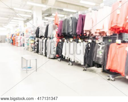 Abstract Blurred Sport And Travel Hypermarket Aisle With Colorful Shelves As Background