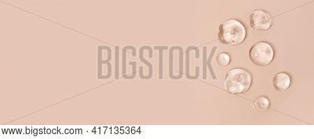 Lotion Transparent Gel Drops Texture Background, Close-up Drops Transparent Cosmetic Aloe Vera Gel O