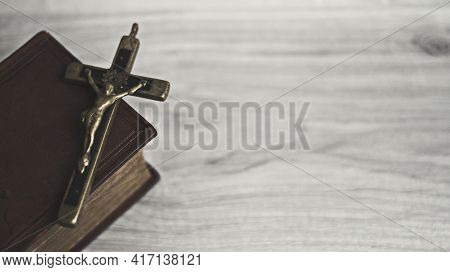 Holy Bible Christian Religion Book And Cross Made Of Brass In Antiquity, Vintage, Dark Tone, Belief