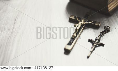 Cross Made Of Brass In Antiquity, Vintage, Dark Tone, Belief Concept ,copy Space