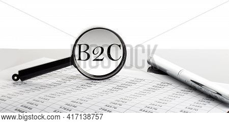 Magnifying Glass With Text B2c On The Chart Background With Pen
