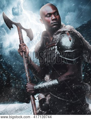 African Viking In Protective Armor And Deerskin With Axe In Blizzard